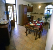 Kitchen and dining area of the Shakespeare Apartment