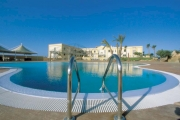 View of the hotel with the swimming pool