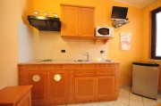 Salmon one-room flat kitchenette