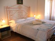 Doppia camera da letto dell'appartamento di Papavero