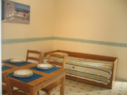 Dining area with the convenient location of a single bed