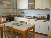 Kitchen of the Papavero Apartment with dinig table and chairs
