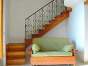 Amalfi Coast Accommodation: Sofa-bed and the staircase which takes to the mezzanine level with the double bed of Ludovica Accommodation Type D along the Amalfi Coast