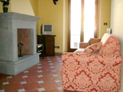 Apartment in Florence: Living-room with fireplace and sofabed of Donato Apartment in Florence