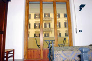 Apartments Florence Italy: Double Bedroom with balcony of Bonciani Apartment in Florence Italy