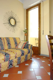 Apartments Florence Italy: Living room with bed-sofa of Bonciani Apartment in Florence Italy