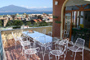Apartment in Sorrento: Terrace with table and chairs and a beautiful sea-view of Chiara Apartment in Sorrento